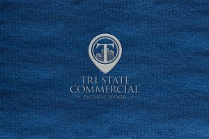 TSCR logo embroidered on blue canvas